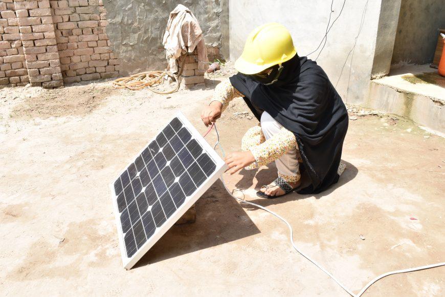 Female solar technician