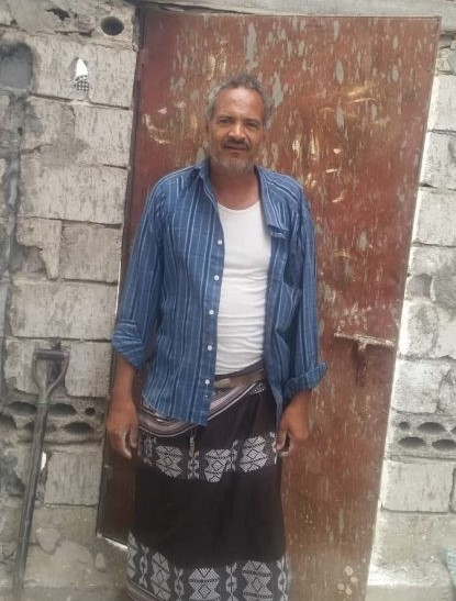 Beneficiary standing outside his house in Arashy, Yemen