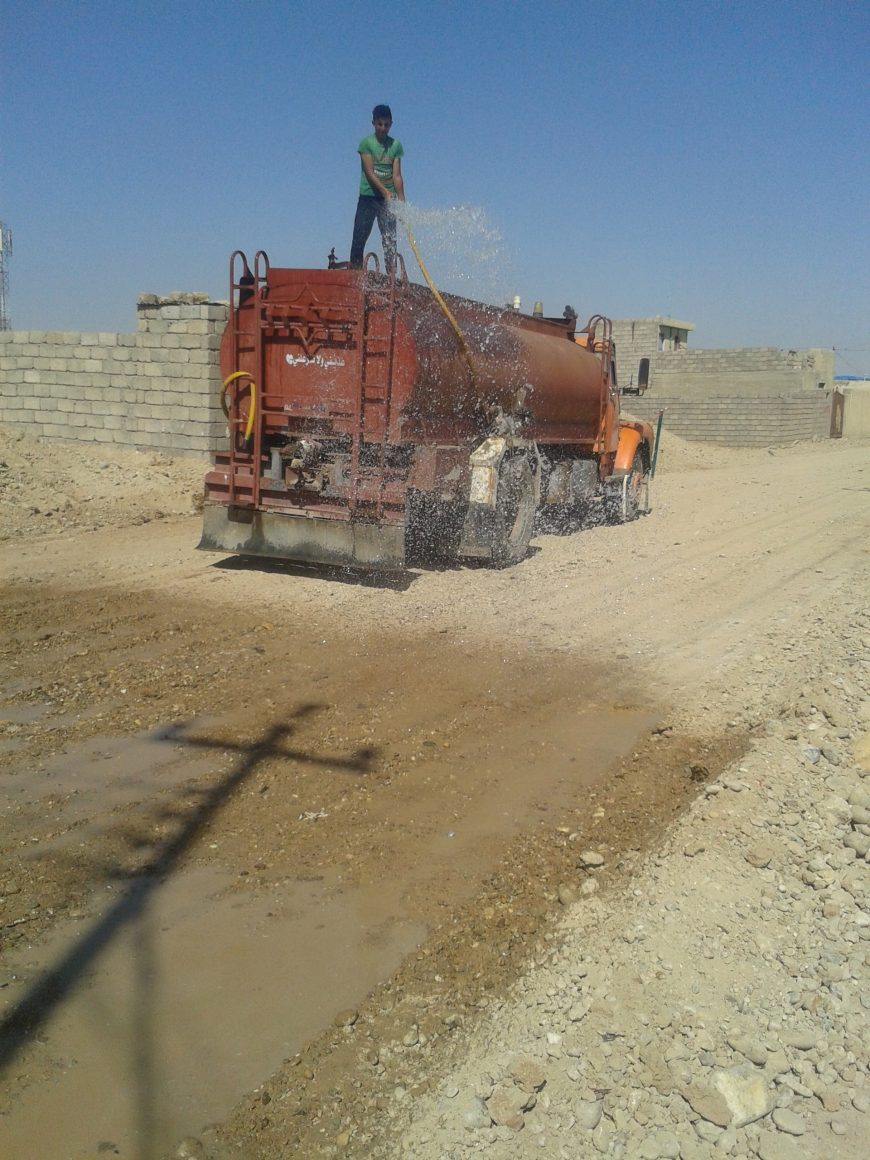 Truck wetting the road