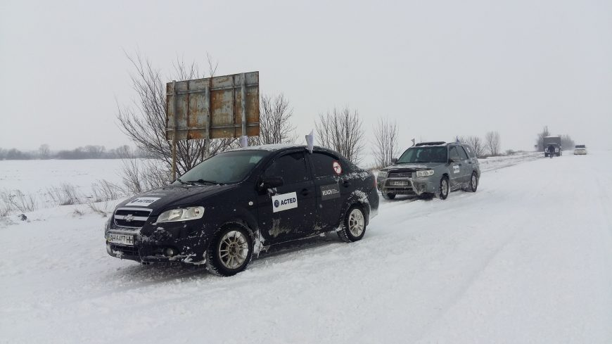 A team of enumerators are in the field, braving severe weather conditions